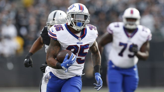Buffalo Bills running back Mike Gillislee (35) runs for a first down against the Oakland Raiders in the first quarter at Oakland Coliseum.