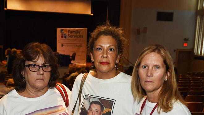 From left, Sheree Gover of Clinton, Ligia Plain of the Town of Poughkeepsie, and Donna Bendel of LaGrange before the start of Wednesday's Poughkeepsie Journal Media heroin forum at the Family Partnership Center.
