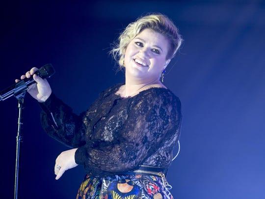 Singer Kelly Clarkson performs during Celebrity Fight Night XXI at the JW Marriott Desert Ridge Resort & Spa in Phoenix in March.