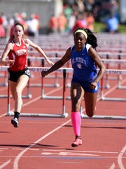 St. Peter's Alysse Wade wins her heat of the Division III 100 hurdles Friday in Ohio State's Jesse Owens Memorial Stadium.