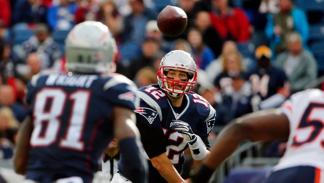 New England Patriots quarterback Tom Brady (12) throws the ball to tight end Timothy Wright (81) during the second half  against the Chicago Bears at Gillette Stadium.