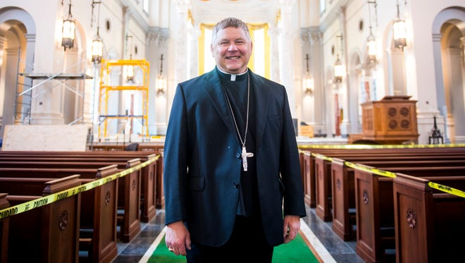 Bishop Richard Stika stands inside the new Cathedral of the Most Sacred Heart of Jesus on Northshore Drive in Knoxville on Thursday, Feb. 15, 2018.