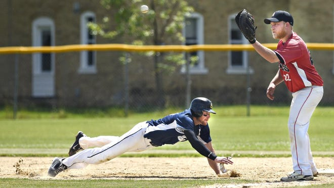 Luxemburg's Luke Harren dives safely back into first base under the pick off attempt by St. Augusta's Brady Graft in the fourth inning Sunday in Luxemburg.