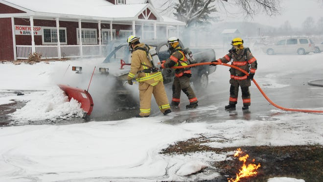 This plow truck, owned by Lautenbach's Orchard, 9197 Wisconsin 42, caught on fire at 8:15 a.m. Monday while plowing a light snow. Photo by Tad Dukehart.