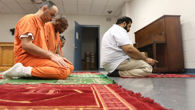 Imam Mohammed Ibn Ahmed leads an afternoon prayer service at the Bergen County Jail in Hackensack.