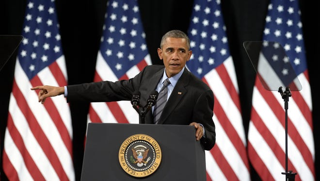 President Obama defends his executive action on immigration reform at Del Sol High School in Las Vegas on Friday.
