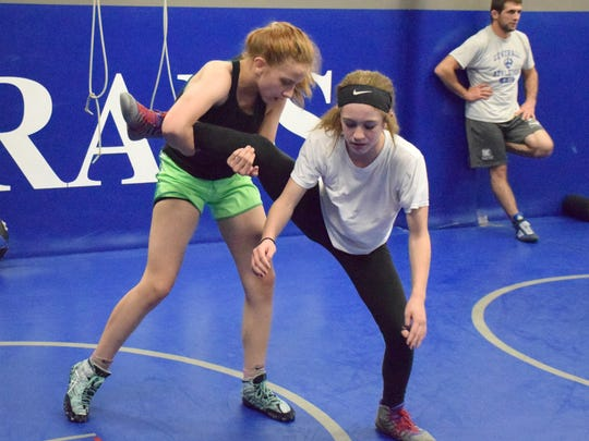 Brianna Reep, 13, left, and Jaylee Hatcher, 12, both of Stuarts Draft, work out with the Mat Pack Wrestling Club in the wrestling room at Washington & Lee University in Lexington, Va., on Wednesday, May 10, 2017.