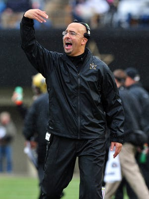 Vanderbilt Commodores head coach James Franklin calls his team to the sideline against the Georgia Bulldogs during the first half at Vanderbilt Stadium.