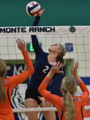 Damonte's Meagan Carlson goes up for the spike against Douglas in Tuesday's game at Damonte Ranch.