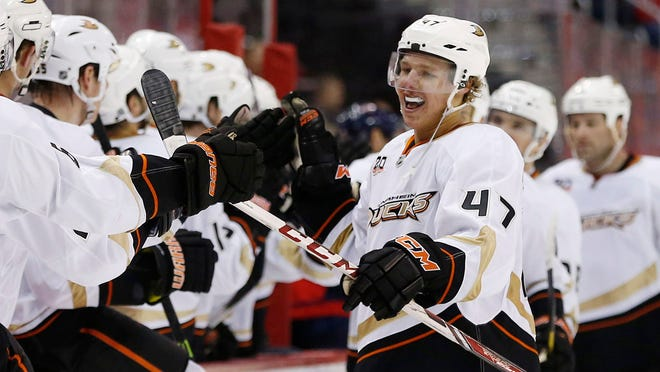 Ducks defenseman Hampus Lindholm cerebrates with teammates after scoring a goal against the Capitals in the third period at Verizon Center.