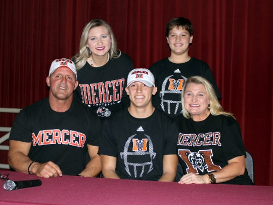 Northview's Luke Ward (center) poses with his family