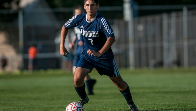 Marysville's Michael Lansky attacks the ball during a soccer game.