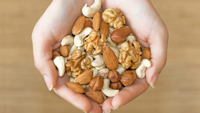 Various nuts in hands