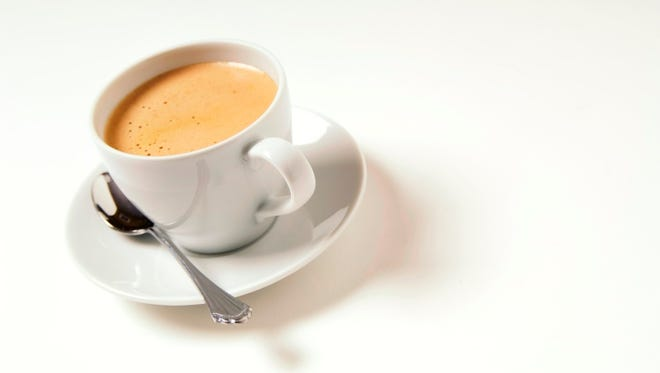 Cup of cafe espresso coffee on a white background.