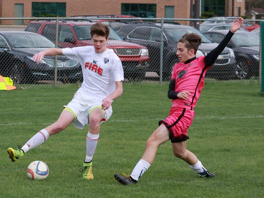 Cooper Grosteffon from Lakeview High School dribbles