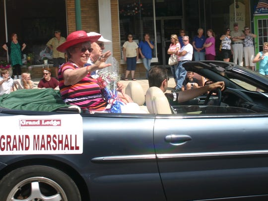 Marilyn Smith, who died Friday, is pictured waving to parade watchers during the 2013 Yankee Doodle Days parade through downtown Grand Ledge. She served as the parade's Grand Marshal that year.