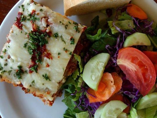 Eggplant Parmesan and a green salad make for lunch at Dandelion Deli.