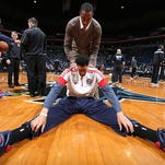 AD, stretches prior to a recent game.