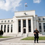 The Federal Reserve said the U.S. economy grew moderately in July and August.