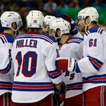The Rangers' Dan Girardi, J.T. Miller, Derick Brassard, Keith Yandle and Rick Nash celebrate a goal in the Eastern Conference Final last May.