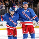Mats Zuccarello (left) celebrates a third-period goal by Rangers captain Ryan McDonagh (right) in Thursday's win over St. Louis.