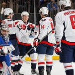 Alex Ovechkin (8) and the Washington Capitals celebrate one of six straight goals in front of a bewildered Henrik Lundqvist (30) Sunday.