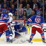Henrik Lundqvist, center, and Jesper Fast (19) earned two Rangers regular-season awards Thursday