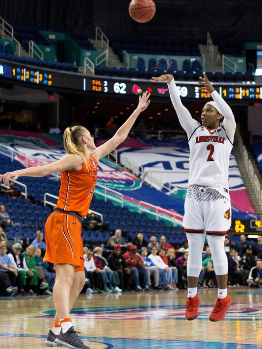 Louisville's Myisha Hines-Allen (2) attempts a shot over Virginia Tech's Regan Magarity (11) during the second half of an NCAA college basketball game in the Atlantic Coast Conference tournament in Greensboro, N.C., Friday, March 2, 2018. (AP Photo/Ben McKeown)