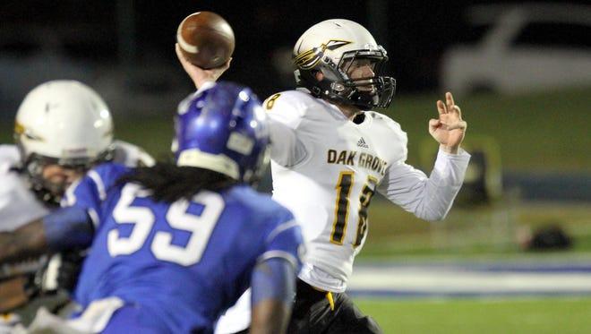 Oak Grove quarterback Alex Ward finds an open receiver Friday night against Meridian.