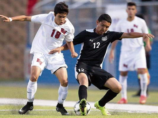 Horizon's Fernando Gallardo battles for the control of the ball during the first half of Thursday evenings state 5A semifinal againt Georgetown east view.
