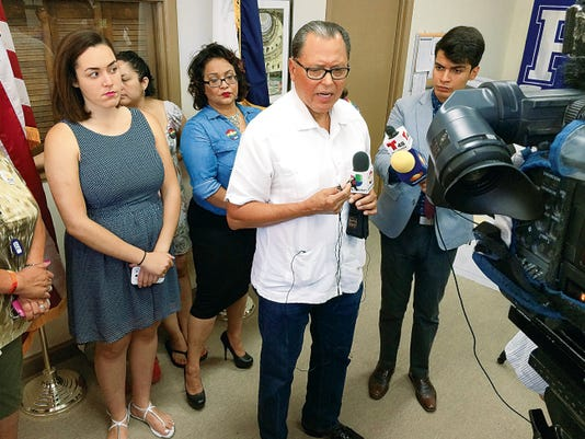 State Sen. José Rodríguez speaks about the recent Supreme Court ruling on same-sex marriage Monday at his offices. Also appearing with him are, from left, Grace Perez, Claudia Yoli, and Victoria Rodriguez. The Rev. Deborah Clugy-Soto is behind Rodriguez.