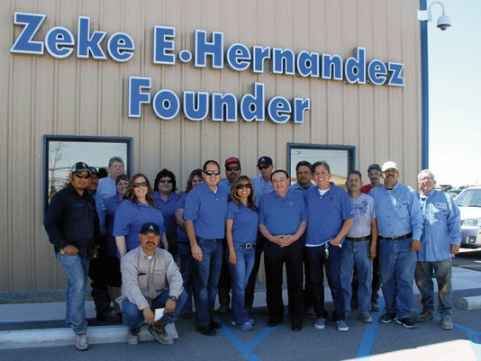 Employees of ZH Services stand outside of the newly opened building for the business. Zeke Hernanez, owner of ZH Services, has owned the business for four years.