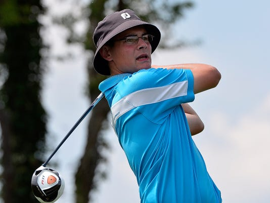 Andrew Davis tees off on No. 18 during the York County Junior Golf Association Match Play Championship at Springwood Golf Course on Wednesday. Davis beat Trevor Sweitzer, 3&2, to win the boys' title.
