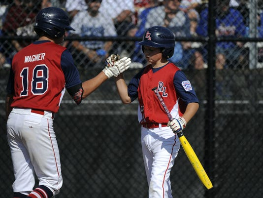 Red Land's Cole Wagner (18) and Jake Cubbler during the Mid-Atlantic Final at Eastern Regional Little League Tournament at Breen Field in Bristol on Sunday. Wagner pitched a 12-0 shutout against Jackson Township, N.J., in the final game of the Little League World Series Mid-Atlantic Regional.