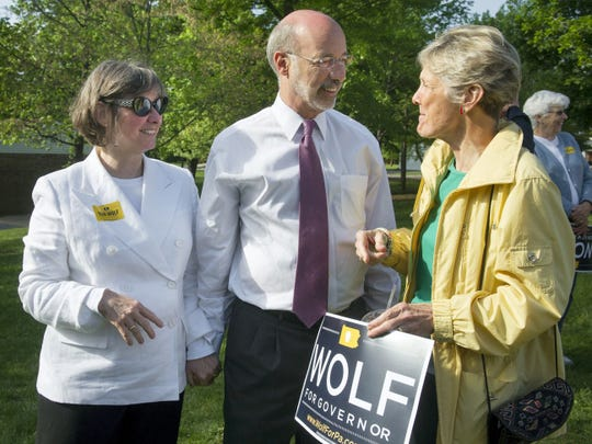 From the left, Frances Wolf holds Tom Wolf's hand at a rally in Mount Wolf on May 18, 2014, while talking to cousin Coni Wolf of Spring Garden Township. Tom and Frances were involved in politics as contributors before, but this was their first campaign as candidate and spouse.