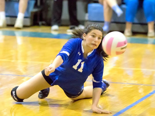 Carlsbad's August Tiller digs one off the floor in