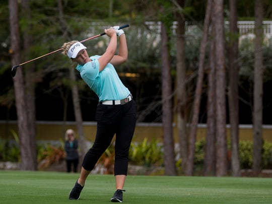 LPGA tour pro Brooke Henderson hits from the fairway during the first round of the CME Group Tour Championship at Tiburon Golf Club Thursday, Nov. 16, 2017 in Naples.