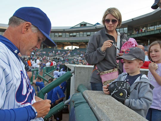 From 2010: Iowa Cubs' manager Ryne Sandberg signs autographs for fans along the third baseline before a game against the Memphis Redbirds at Principal Park.