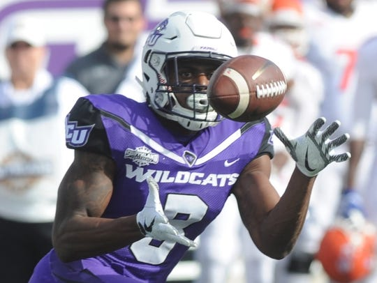ACU's Carl Whitley catches a Luke Anthony pass in the