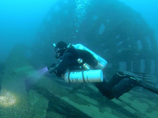 Shipwreck hunter and diver Marty Lutz swims near the
