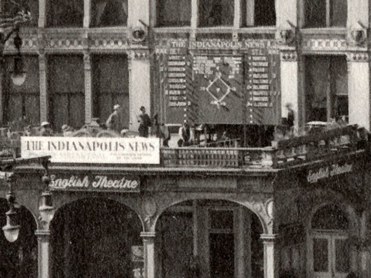 Inset photo of the electronic scoreboard on the portico of the English Hotel and Theatre