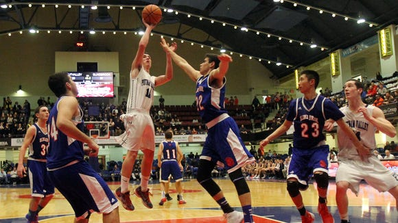 Putnam Valley's Kevin Gallagher (14) is surrounded by Blind Brook defenders as he puts up a shot during the boys Class B semifinal at the Westchester County Center in White Plains Feb. 24, 2016. Putnam Valley won the game 48-39.