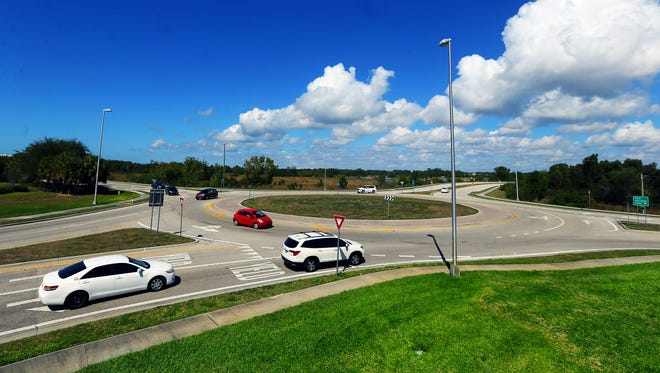 Traffic flows through the roundabout at Williams Road and Via Coconut Point in Estero on Sunday. The intersection of Winkler Avenue and Challenger Boulevard is being considered to become a roundabout by the Lee Metropolitian Planning Organization.