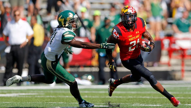 Maryland defensive back Sean Davis, right, rushes past South Florida wide receiver Ryeshene Bronson after intercepting a pass in the second half of an NCAA college football game, Saturday, Sept. 19, 2015, in College Park, Md. Maryland won 35-17.