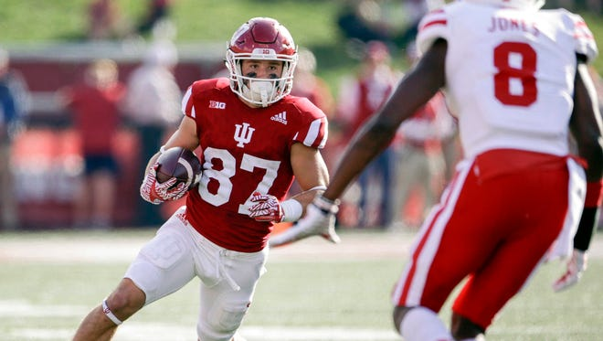 Indiana Hoosiers wide receiver Mitchell Paige (87) looks to avoid being tackled by Nebraska Cornhuskers cornerback Chris Jones (8) during the first half of the game at Memorial Stadium.