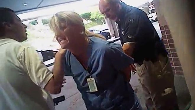 FILE - In this July 26, 2017, frame grab from video taken from a police body camera and provided by attorney Karra Porter, nurse Alex Wubbels is arrested by a Salt Lake City police officer at University Hospital in Salt Lake City. Utah Police Detective Jeff Payne was fired Tuesday, Oct. 10, 2017, in a case that became a flashpoint in the ongoing national conversation about police use of force. (Salt Lake City Police Department/Courtesy of Karra Porter via AP, File)