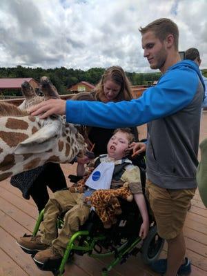 Ten-year-old Alex's wish was to meet the giraffes at Animal Adventure Park in Harpursville.