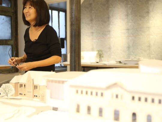 Maya Lin in her Manhattan studio with a model of her