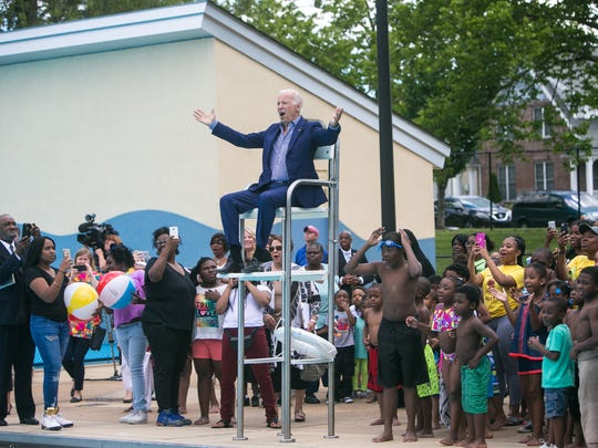 Former Vice President Joe Biden sits in a lifeguard chair at the dedication of the Joseph R. Biden Jr. Aquatic Center in Wilmington earlier this year.