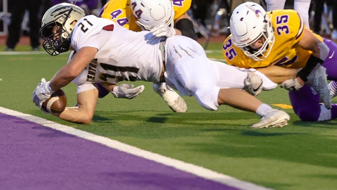 Andover Central's Jacob Rees dives for the end zone in Friday's loss to Valley Center.